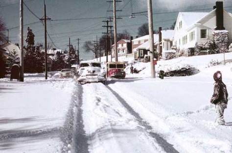 The challenge of driving on Queen Anne Hill through the Big Snow of 1950.  This slide by Horace Sykes looks west on Prospect Street through its intersection with Nob Hill Avenue N.