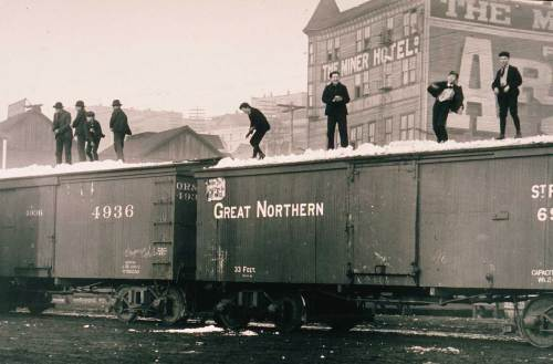 Boys will be snowballers with snow brought to them from Stevens pass by the Great Northern Railroad.  The scene was photographed ca. 1899 at the waterfront foot of Union Street on what was then still called Railroad Avenue