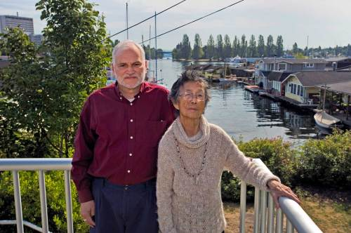 NOW: With Portage Bay and the Montlake Cut behind them, linguists Jay Miller and Vi Hilbert pose beside a small park at the foot of Shelby Street.