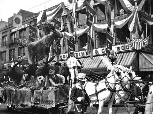 THEN: The Moose float heads south on First Avenue at Columbia Street during the 1912 Potlatch parade of fraternal and secret societies. Behind them are Julius Redelsheimer's clothing store and the National Hotel, where daily room rates ran from 50 cents to a dollar.
