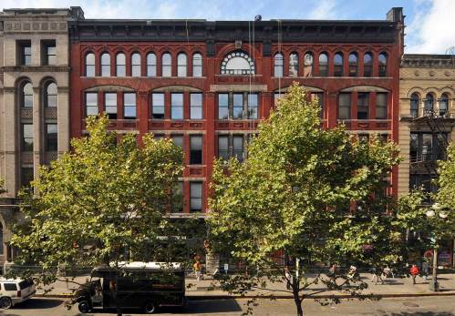 NOW: Jean Sherrard gained entrance to the second floor of another post-fire building across First Avenue South to record this view of the restored Terry-Denny building with the trim address, 111 First Ave. S.