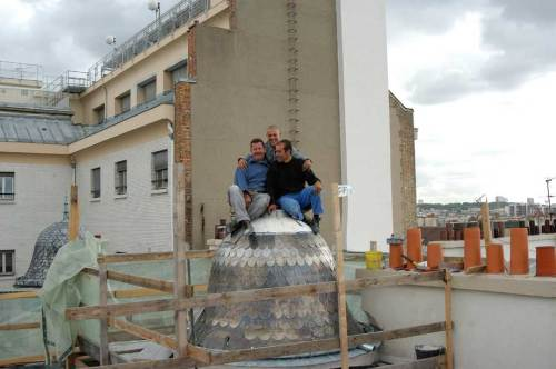 Three roofers, Francis, Frank, & Manuel (L to R), atop the little dome at 63-65 rue des Archives in the 4th arrondissment.