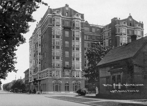"THEN: The Perry Apartments is nearly new in ""postcard artist"" M. L. Oakes look at them south on Boren to where it intersects with Madison Street. (Courtesy John Cooper)"