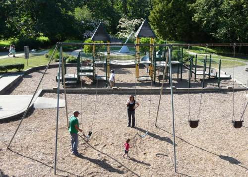"The emphasis on this ""repeat"" is on the swings more than the place.  Much of the Cowen Park ravine was developed into a playfield with dirt borrowed from the Interstate-5 construction in the 1960s.  The site of the historical playground by the creek is now covered with it.  (by Paul Dorpat)"