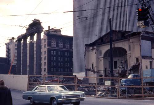 Gowey returned on March 21, 1966 to record the razing of the Plymouth church with a view that looks southwest thru the intersection of Sixth Avenue and University Street.  The columns that seemed doomed on the left were instead saved and moved to the northwest corner of Pike Street and Boren Avenue where they still stand to puzzle most motorists and pedestrians. We have written a piece about this, but will save the details for another occasion.