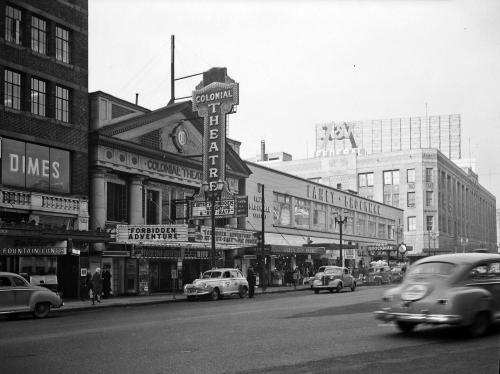 The Colonial on the west side of 4th Ave. between Pike and Pine, ca. 1947.