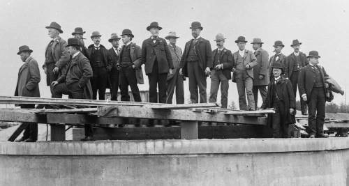 Standing in a study line withn the Volunteer Park reservoir's construction zone, the members have spread themselves out for distinction.  Wilse, again on May 1, 1900.