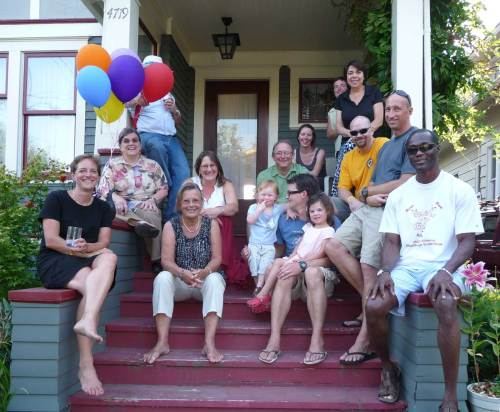 From left to right:  * On the left riser: Dick Barnes behind the balloons, Candy Barnes, and Claudia Levi  * On the steps clockwise starting left top:  Meg Pasquini, Gina McManus, Andy Williams, Brian McManus, Mazie McManus, Charlie McMansu and Gisela Levi  * On the right riser from top to bottom:  Jane Shapira, Cynthia Williams, Shaun Darragh, Chris Way, and Sam Miller