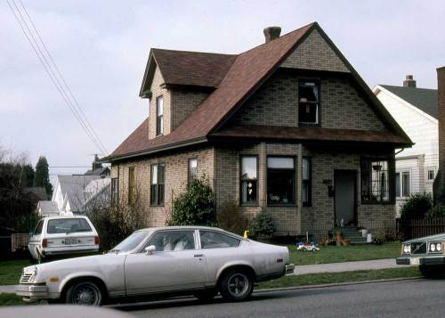 "The same house on 10th on Feb. 7, 1981.  Someone sold the owners a covering of ""war brick"" probably in the 1940s, and it is still in place here in '81."