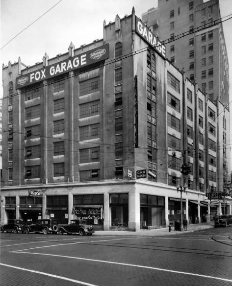 THEN: With her or his back to the Medical-Dental Building an unidentified photographer took this look northeast through the intersection of 6th and Olive Way about five years after the Olive Way Garage first opened in 1925. (Courtesy, Mark Ambler)