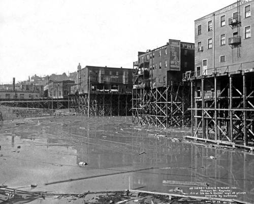 The tenement on the far right sat at the northwest corner of 6th Avenue and Lane Street in what is now commonly refered to as Chinatown.  The view looks northeast although more north than east.  The photo is used courtesy of the Museum of History and Industry, aka MOHAI.