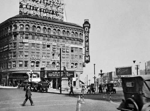 THEN: Thanks to Pacific reader John Thomas for sharing this photograph recorded by his father in 1927. It looks north across Times Square to the almost completed Orpheum Theatre. Fifth Avenue is on the left, and Westlake on the right.