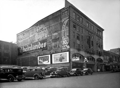The Orpheum Automobile Hotel was the cause for our reacquaintance a few years ago.  Do you remember?  You sent me off to Eric Lange at the Bellevue archives where I discovered this beautiful (and now digitally cleaned up) 1937 King County WPA survey photo.  I spent considerable time walking the site and offer here the gorgeous original and my 2007 shot, taken with a Nikon Coolpix 995.  The mosaic brickwork on the facade is just visible, peeking out from under the metal screens, if you're looking for it. If I recall correctly, the stone facing around the driveway openings is gone, a victim of the same remodel. I can almost imagine men in tails and women in furs, pulling up to a waiting valet attendant in bow tie and white gloves, before crossing the street for a concert at the Orpheum. Maybe one day I'll return with my 4x5 on a sunny winter Sunday for a serious attempt.  The WPA photographer who took the survey photo was a real artist.