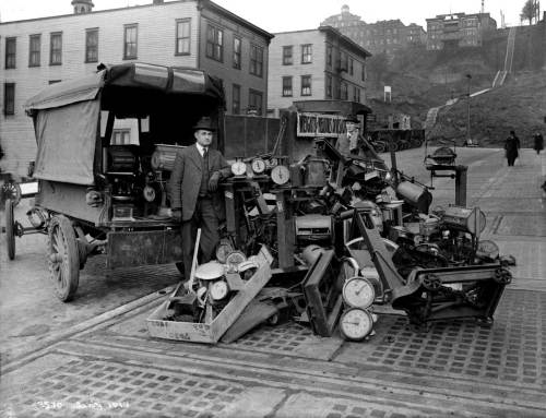 THEN: A winter of 1918 inspection of some captured scales on Terrace Street. The view looks east from near 4th Avenue. (Courtesy City Municipal Archives)