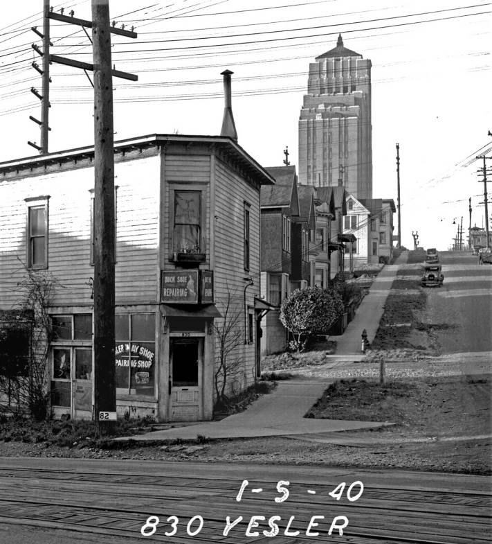 """THEN: Harborview Hospital takes the horizon in this 1940 recording. That year, a hospital report noted that """"the backwash of the depression"""" had overwhelmed the hospital's outpatient service for """"the country's indigents who must return periodically for treatment."""" Built in 1931 to treat 100 cases a day, in 1939 the hospital """"tries bravely to accommodate 700 to 800 visits a day."""""""