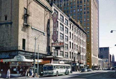 "THEN:  Lawton Gowey's afternoon look south on the east side of First Avenue from Madison Street during the ""spring of love"" in 1967.  All three structures – notably the Rivoli Theatre at Madison St. on the left and the Stevens Hotel at Marion – were then slated for destruction."
