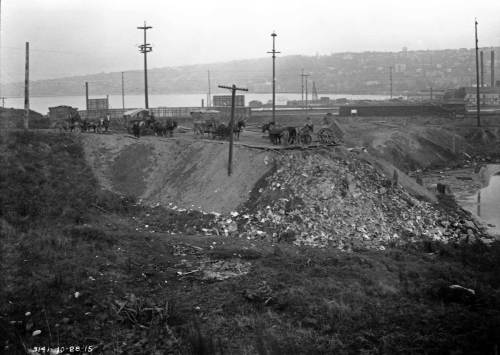 Work in progress on the landfill that reclaimed the swimmer's cove for commerce.   The photo is from the Municipal Archive and is dated Oct. 28, 1915.