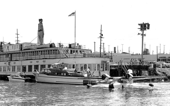 THEN: Photographed in the late 1950s, the floating restaurant's huge on deck hooligan got no competition as yet from the Space Needle (1962) in breaking the horizon.