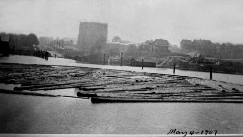 Before the fill and, most likely recorded from the Westlake trestle.  Part of the cover is here used by Western Mill for its mill pond.   The tank is on the west side of 9th Avenue near Republican Street.  (Courtesy, Michael Maslan)
