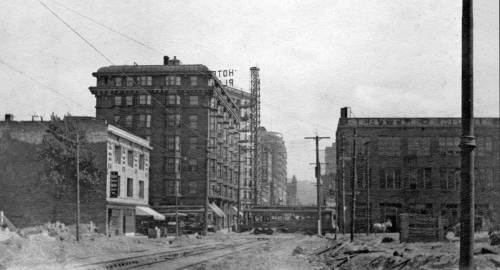 The flatiron Plaza Hotel is left-of-center, and to this side of it at the northeast corner of 4th and Pine is the new masonry structure that took the place of the Lutheran's church.  This dates from ca. 1909 near the end of the Denny Regrade, or that part of it that smoothed the old hill neighborhood as far east as Fifth Avenue.