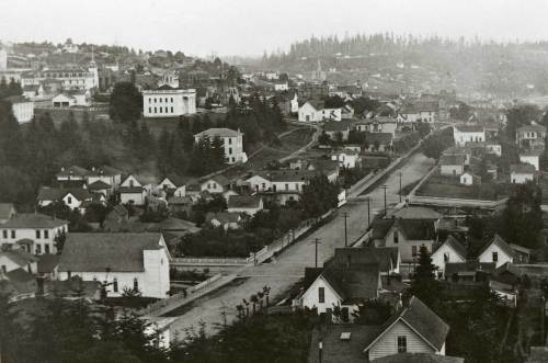 Looking south over Third Avenue from Denny Hill ca. 1885.  The first Lutheran parish in Seattle, the Swedish Lutheran Church, still bottom-left near the northeast corner of Third Avenue and Pike Street.  Note territorial university on Denny Knoll and behind it and to the left the first part of Providence Hospital at the southeast corner of 5th and Spring.