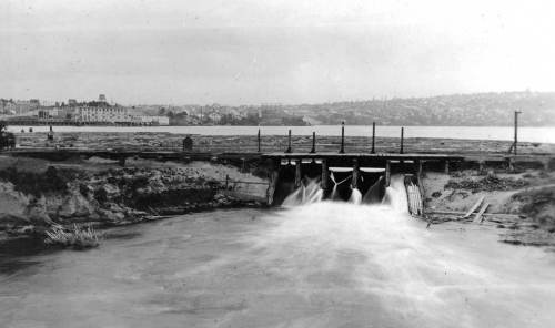 Four years later, looking east from the Fremont (still) low bridge to the dam and flume in 1907.  Here work has begun on the Gas Works, at the center.