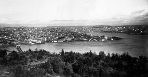 From Queen Anne Hill, ca. 1911, most of Wallingford with the temporary Stone Way Bridge (1911-1917) lower left, and the Latona Bridge (1891-1918) upper-right, in the distance beyond and above the Gas Works.