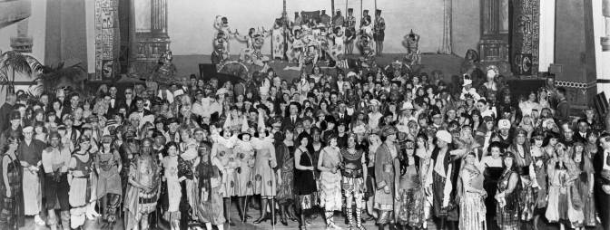 "THEN: Revelers pose on the Masonic Temple stage for ""A Night in Old Alexandria,"" the Seattle Fine Art Societies annual costume ball for 1921. (Pic courtesy of Arthur ""Link"" Lingenbrink)"