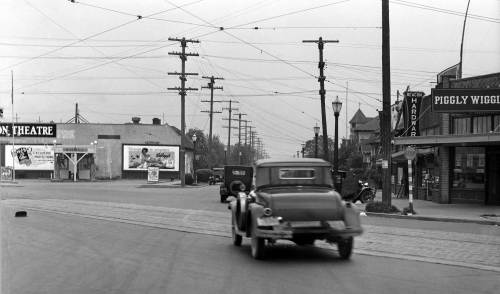 THEN: A speeding coupe convertible heads north on Beacon Hill's 15th Ave. S. in 1937.