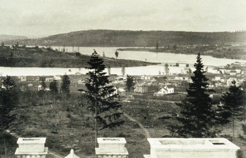 "Another early look at the Latona Bridge - but not as early.  This view from the cupola of Denny Hall dates from 1896 when the campus opened or soon after.  Queen Anne  Hill covers most of the horizon, although West Seattle takes some of it rare left.  The ""Wallingford Peninsula"" and future home of the Gas Works holds above the bridge.  The north end of Capitol Hill enters from the left to connect with the bridge.(Courtesy University of Washington Libraries, Special Collections)"