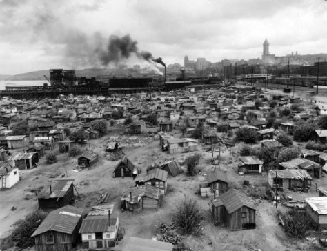 Hooverville classic, looking north along the waterfront with the First Hill horizon, upper-right.