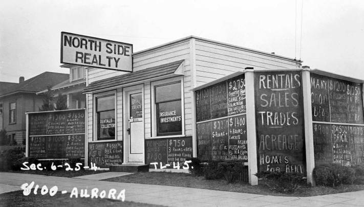 THEN: Chalk-written real estate notices to the sides of Seattle's Aurora Speedway in 1937 prelude by several decades the profession's book and computer listings and the expectation of some that an agent will now be driving a Mercedes.  (Courtesy, Washington State Archives, Bellevue Community College branch.)