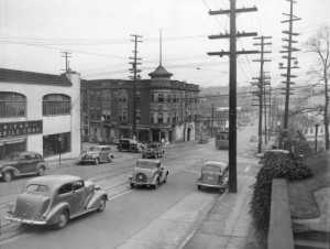 An earlier year at the intersection, this time looking east on Madison and thru Broadway.  We don't know the date.  What you think - judging by the motors?