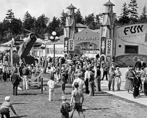 THEN: Far-left, Playland's Acroplane, a carni' flight-simulator, stands admired by future pilots in 1932. Behind them sprawls the amusement park's fated Fun House. (Courtesy, Ron Edge)