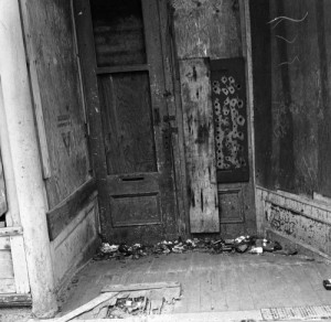 Frank Shaw's March 13, 1976 record of the Leader Building's front door.  The Leader was built mid-block on the west side of First between Bell and Battery.  It was early and made of bricks, which was rare.