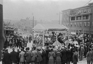 Looking east on Olive from Fourth Avenue during a 1911 Potlatch parade.  The Waverly Hotel is on the right - future home of the Mayflower Hotel.   The float is promoting rugs.