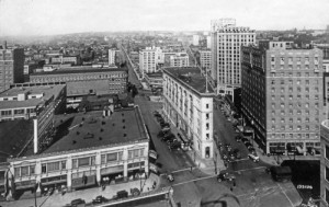 The flat-iron Times Building seen from an upper floor of the Securities Building at 3d and Stewart.  The Mayflower Hotel is on the right, behind it the Medical Dental Building with Capitol Hill on the horizon.
