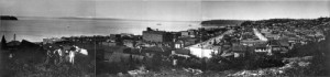 A 1912 look northwest into Belltown from the southern summit of Denny Hill.  Both the West Seattle and Magnolia peninsulas show their heads here.   (Courtesy, MOHAI)