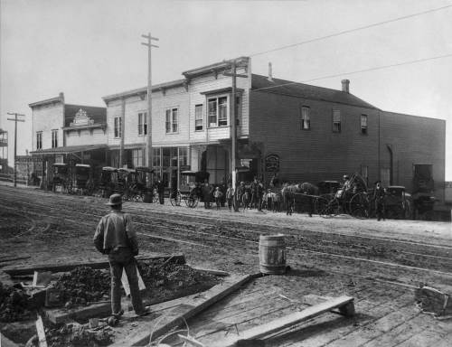 THEN:  Louis Rowe's row of storefronts at the southwest corner of First Ave. (then still named Front Street) and Bell Street appear in both the 1884 Sanborn real estate map and the city's 1884 birdseye sketch.  Most likely this view dates from 1888-89.  (Courtesy: Ron Edge)