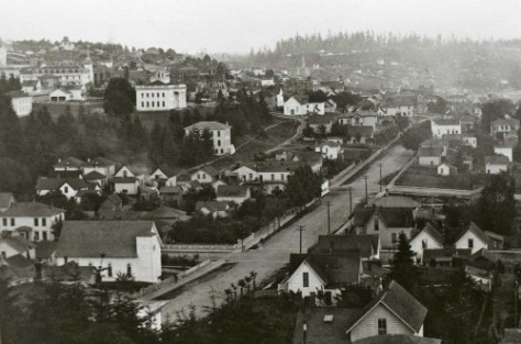 Part of a three-part pan of the city dated 1885, it includes, bottom-left, the Swedish Lutheran Church on the east side of 3rd Ave., second lot north from Pike Street.  The territorial university is on its knoll (Denny's Knoll). . . too.  Beacon Hill makes a horizon upper-right, and First Hill, upper-left.