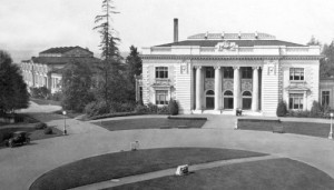 THEN: We suspect that this quiet exposure of the Washington State Building was photographed before the gates of the 1909 Alaska Yukon Pacific Exposition were first opened, and certainly before a bandstand gazebo was built in the grassy circle between it and the Forestry Building.  (Courtesy University of Washington Libraries, Special Collections)