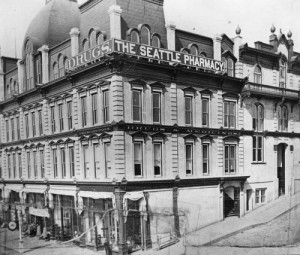 The Frye Opera House ca. 1887 looking northeast across the intersection of Front Street (First Ave.) and Marion Street.