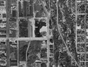 Airport Way proceeds up the middle of this 1946 aerial of what was once the tidelands south of King Street and west of Beacon Hill.  The hill's greenbelt climbs up the right third of the aerial.  Holgate Street leads to Airport Way from about mid-way up the left border of the subject.  In the corner drawn by Holgate and Airport Way appears one of the last submerged vestiges of these tideflats.  Courtesy, Municipal Archive with thanks also to Ron Edge for the scanning.