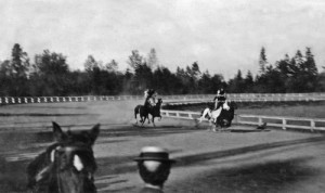 A daring-do interlude - something called a ROMAN RACE performed at Madison Park.  The competing riders each stand on the backs of two galloping horses.  We don't know the date.