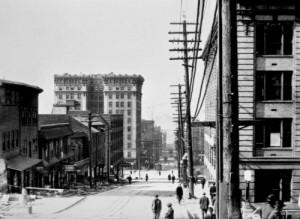 Looking west down Yesler from the east end of City Hall ca. 1912.  The Frye Hotel, on the left, is hear nearly new.