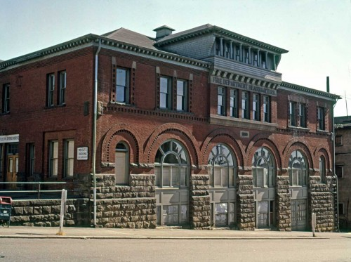 THEN: Constructed in 1890 as the Seattle Fire Department's first headquarters, these substantial four floors (counting the daylight basement) survived until replaced by Interstate Five in the 1960s. (photo by Frank Shaw)