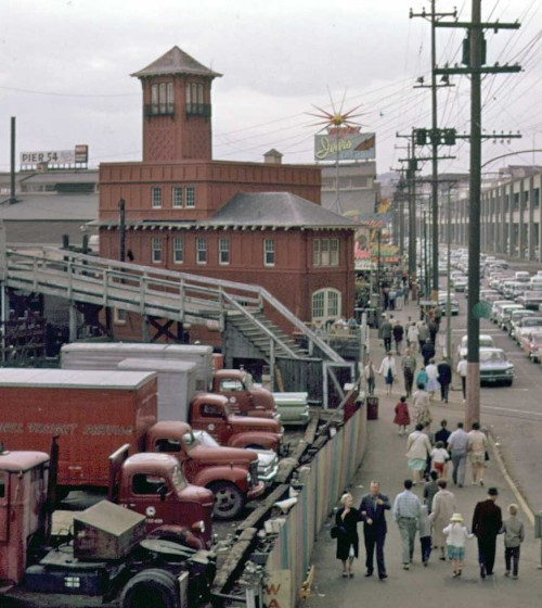 Shaw's station has got its reacoat after Ivar's Century 21 activism, or preparations for it.  This view from the viaduct too, in 1962.  Ivar has also added a gaudy rooftop sign to his Acres of Clams on the far side of the station.