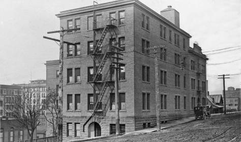THEN: Looking northwest to Seattle General Hospital at the northwest corner of Fifth Avenue and Marion Street, circa 1909. (Courtesy of Michael Maslan)