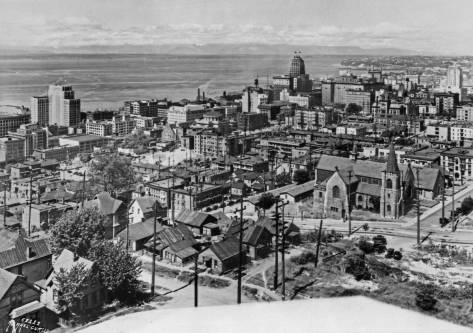 Seattle General Hospital can be found in this 1930 look northwest from Harborview Hospital.  It is the darker architectural mass just above the center of the subject.  Above it and to the left of it is the Northern Life Tower (1928), far right the Washington Athletic Club (1930) and far left, the Exchange Building (1931).  Some of most rumpled housing here on Yesler Hill (this part of First Hill) is revealed bottom-center across James Street from Trinity Episcopal.  It was structures like these that rationalized the razing of the neighborhood - much of its otherwise filled with housing stock much better than this -
