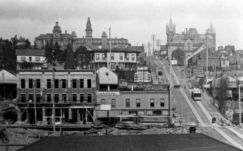 The Northern Pacific Railroad's photographer F. Jay Haynes recorded this look up Madison Street from the waterfront most likely in 1890.  Central School at 6th and Madison is on the right, and no Poplars as yet run a line between the school and Madison.  The central tower of the McNaught mansion, facing Fourth Avenue near Spring Street and the more slender tower of Providence Hospital, left of center, escape the horizon.